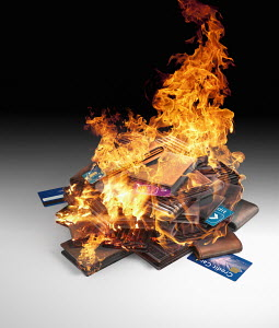 Burning pile of credit cards and wallets