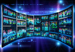 Colorful data graphs on glowing panel of computer screens