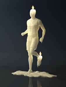 Melting wax candle of man running