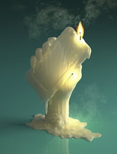 Melting wax candle of hand holding smart phone