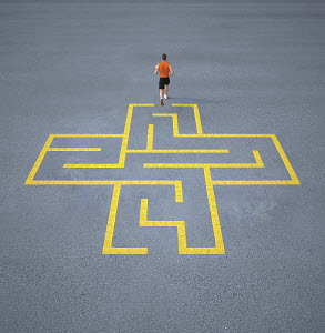 Athlete running out of maze