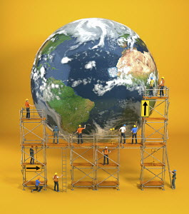 Construction workers on scaffold repairing planet earth