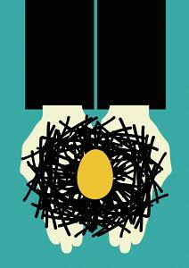 Hands holding egg in nest