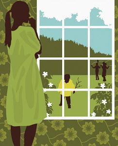 Woman watching children playing in yard