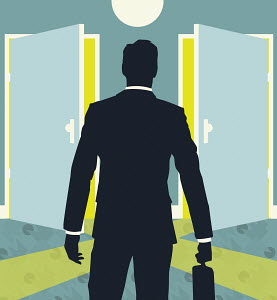 Businessman with briefcase standing at two open doors