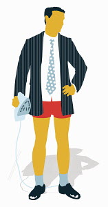 Businessman in boxer shorts holding iron