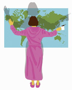 Woman in bathrobe with arms outstretched standing in front of world map