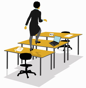 Businesswoman climbing across desks toward desk with M.D. nameplate