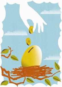 Hand depositing coins into golden egg in nest