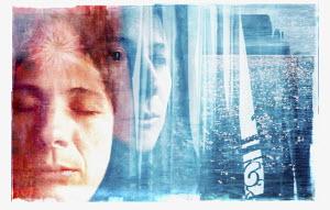 Grieving woman looking at ocean