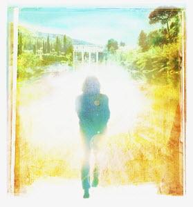 Person walking toward bright future