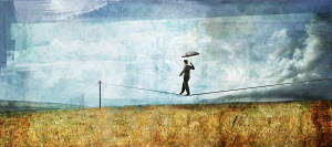 Man with umbrella walking on tightrope telephone wire