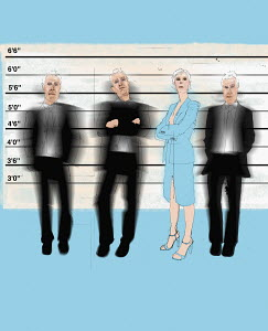Businesswoman measuring up to businessmen