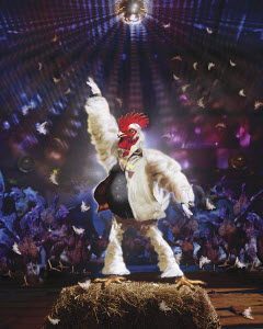 Chicken dancing on hay bale in disco