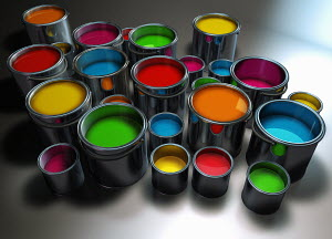 Colorful paint in big and small paint cans