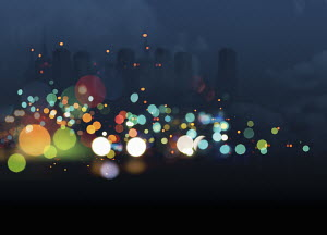 Abstract bright multicolored lights against city skyline