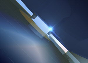Shaft of light shining through narrow slit in blue abstract