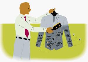Businessman using lint brush on suit jacket