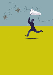 Man chasing butterflies with net