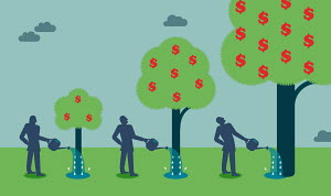 Businessman watering money tree and watching growth
