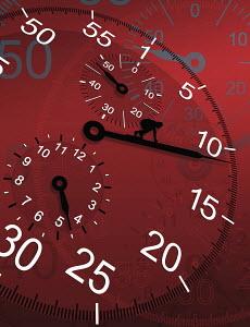 Close up of person crawling along large clock hand