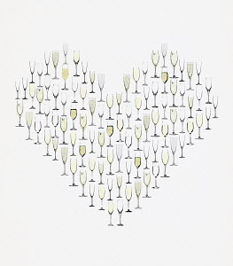 Champagne flutes forming heart
