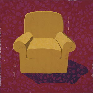 Armchair against patterned wall paper