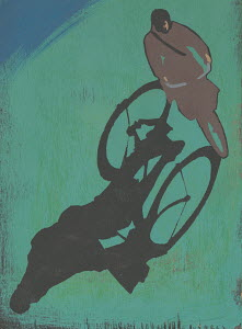 Woman riding bicycle and shadow