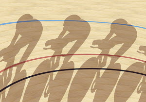 Cyclists casting shadows on indoor track