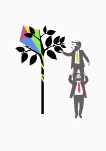 Businessman getting kite from tree