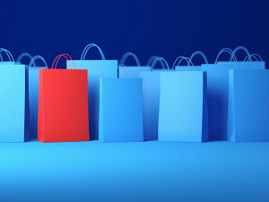Red shopping bag among blue bags