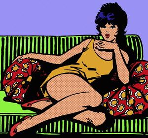 Seductive woman sitting on sofa