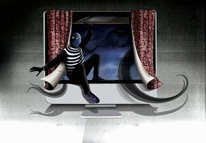 Burglar climbing through computer monitor screen as open window