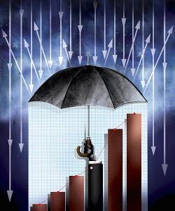 Businessman's arm holding umbrella protecting growth on bar chart