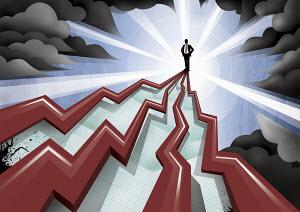 Businessman standing on top of pinnacle of increasing line graphs