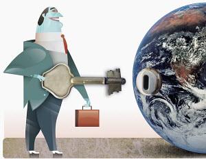 Businessman holding key near keyhole on globe