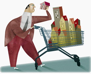 Businessman pushing shopping cart full of buildings