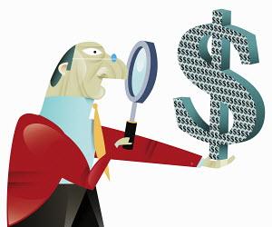 Businessman examining dollar symbol with magnifying glass