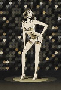 Woman wearing lingerie in spotlight