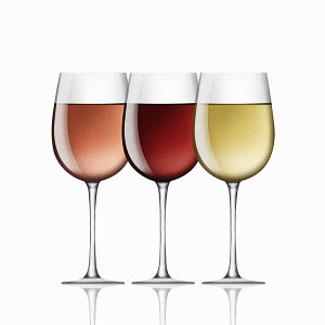 Glasses of red, white and rose wine in a row