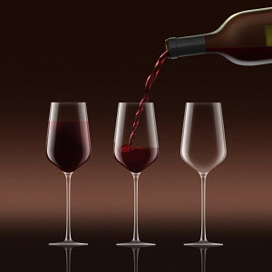 Red wine being poured into three wine glasses in a row