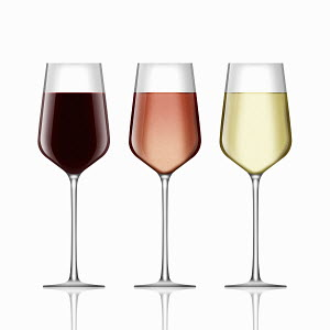 Three wine glasses with red wine, rose wine and white wine in a row