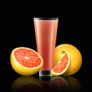 Fresh grapefruit and glass of grapefruit juice