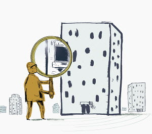 Man looking through building with large magnifying glass