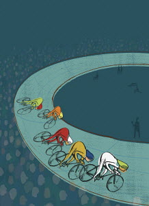 Cyclists racing in velodrome