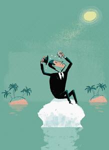 Businessman on melting ice island