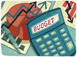 Calculator, graphs and financial figures calculating budget