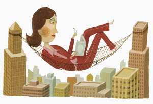 Businesswoman reading in hammock between highrise buildings