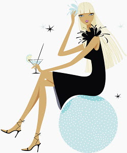 Glamorous woman drinking cocktail