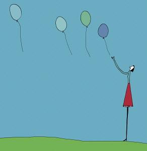 Woman releasing balloons
